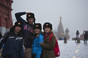 A group of BSU students pose in front of one of the cathedrals in Russia sporting their Team USA gear.