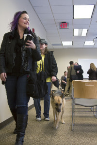 Tiff Cannon Cooper, Amanda Rusk and her seeing-eye dog exit the room after participating on a panel of women with disabilities for an event hosted by Ball State University in Muncie, Ind on March 24. Each member shared their experiences and difficulties, shedding light on the day-to-day struggles and successes of life with a disability.