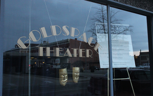 """The sign outside the GoldSpace Theater describes Flo's program, """"Muncie Youth Embrace Creativity."""""""