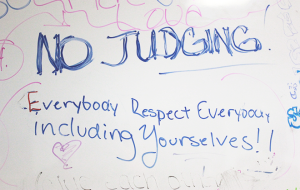 The children at the Goldspace Theater write positive messages on the white board to encourage themselves as well as the other children.