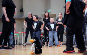 "The kids of the Green group performed their ""Penguin Jive"" for the audience with the help of the Ball State buddies. Their jive included flapping their wings and waddling around the stage."