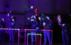 There was an added element to the red group's performance. The stage lights were shut off to reveal the black lights and glowing tubes they were using to create the music.