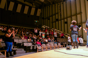 The crowd during the Ball State University Voices of Triumph Gospel Choir performance applauds as a young guest singer leaves the Pruis Hall stage on April 27 in Muncie, Ind. Both the performers and the crowd echoed the energetic optimism vibrating throughout the room.