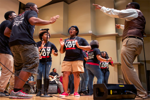 An alumnus of the Ball State University Voices of Triumph Gospel Choir guest-directs a number during the.