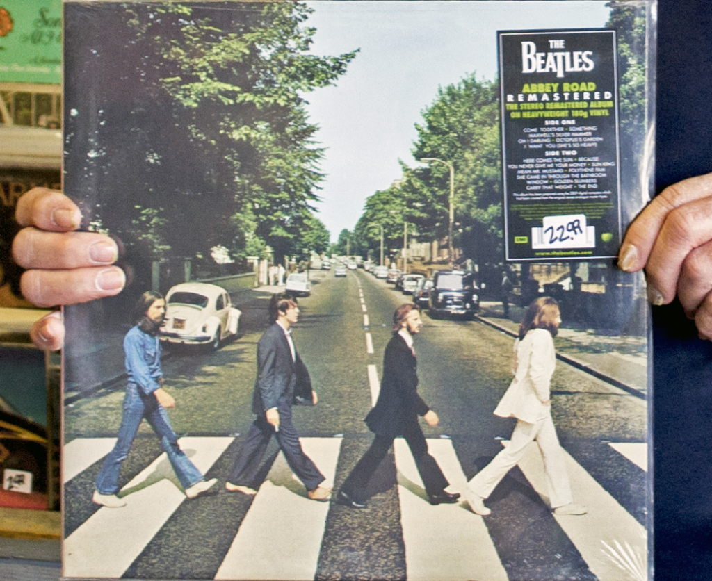 "Dan Walter recommends the iconic ""Abbey Road"" Beatles record to patrons."
